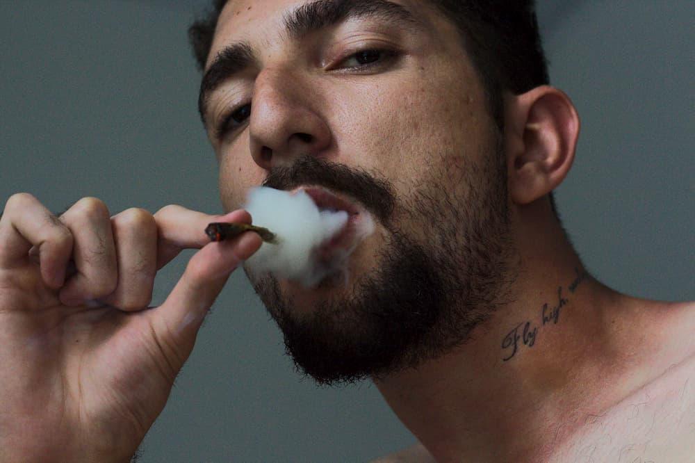 bearded man smokes strong marijuana in 2019