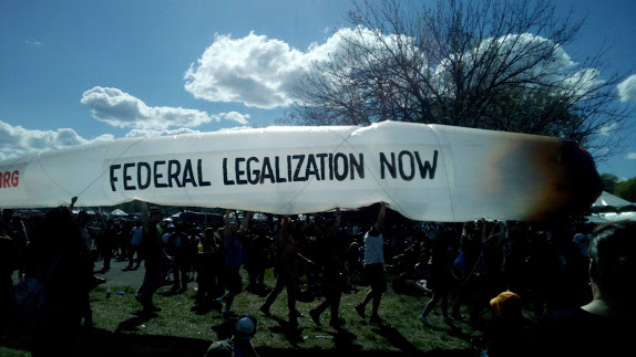 group holds an inflatable blunt at 420 weed festival