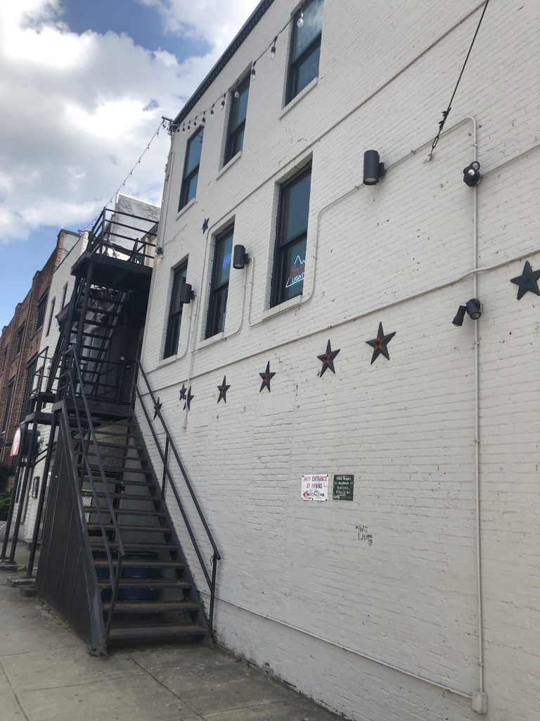 corner view proposed social cannabis club baltimore maryland site photo