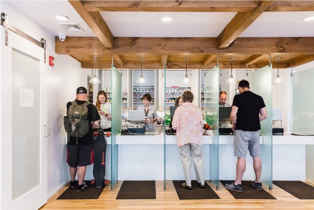 paying customers inside garden remedies cannabis store newton massachusetts